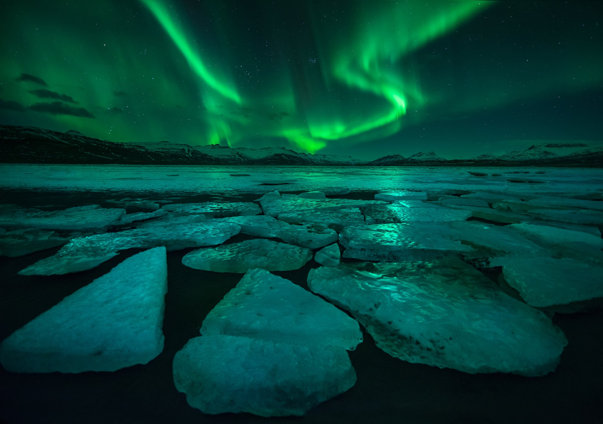 2015, Astronomy, Atmospheric Mood, Aurora Borealis, Beauty In Nature, Cloud - Sky, Color Image, Dramatic Sky, Flowing Water, Horizontal, Iceland, Illuminated, Mountain, Mountain Range, Nature, Night, No People, Outdoors, Photography, Rock - Object, Water,, sarawut intarob