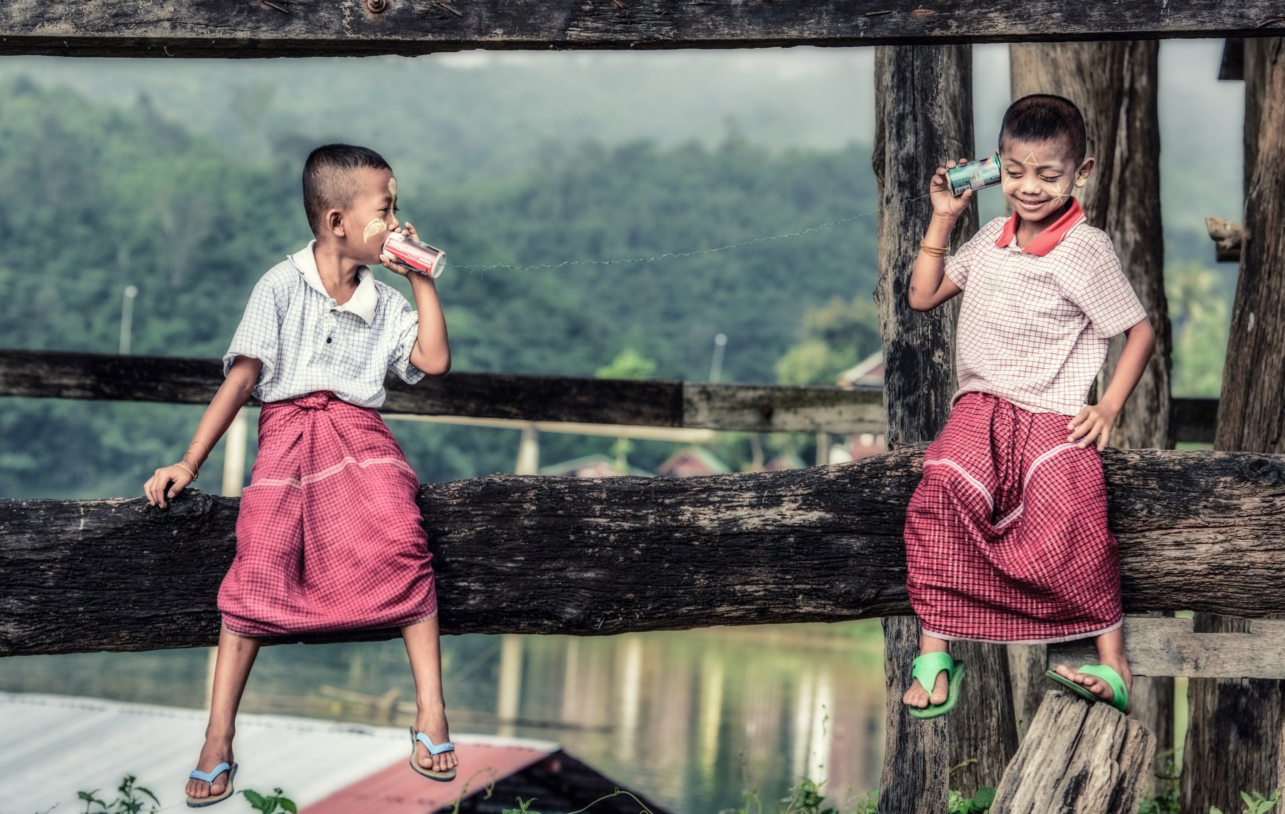 can; kid; tin; phone; child; string; two; toy; young; discussion; clothing; fun; listen; boy; day; horizontal; telephone; discovery; casual; people; technology; childhood; talk; metal; leisure; activity; white; friendship; portrait; cute; smile; connectio, Sasin Tipchai