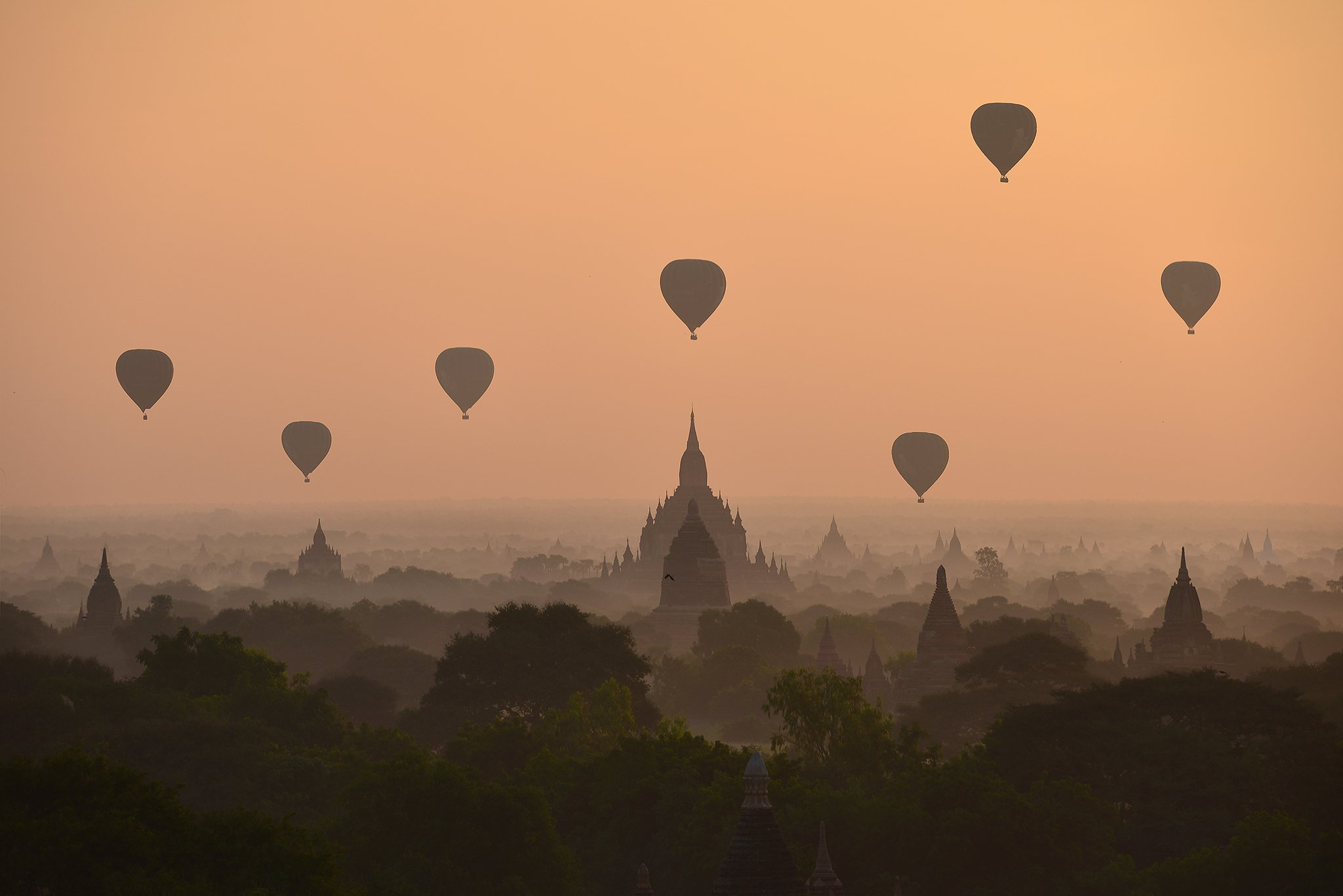 Weather Architecture Bagan Buddhism Built Structure Color Image Flying Fog Horizontal Hot Air Balloon Mid-Air Mode of Transport Mountain Myanmar Nature No People Outdoors Pagoda Photography Silhouette Sky Sunrise - Dawn Temple - Building Transportation Tr, sarawut intarob
