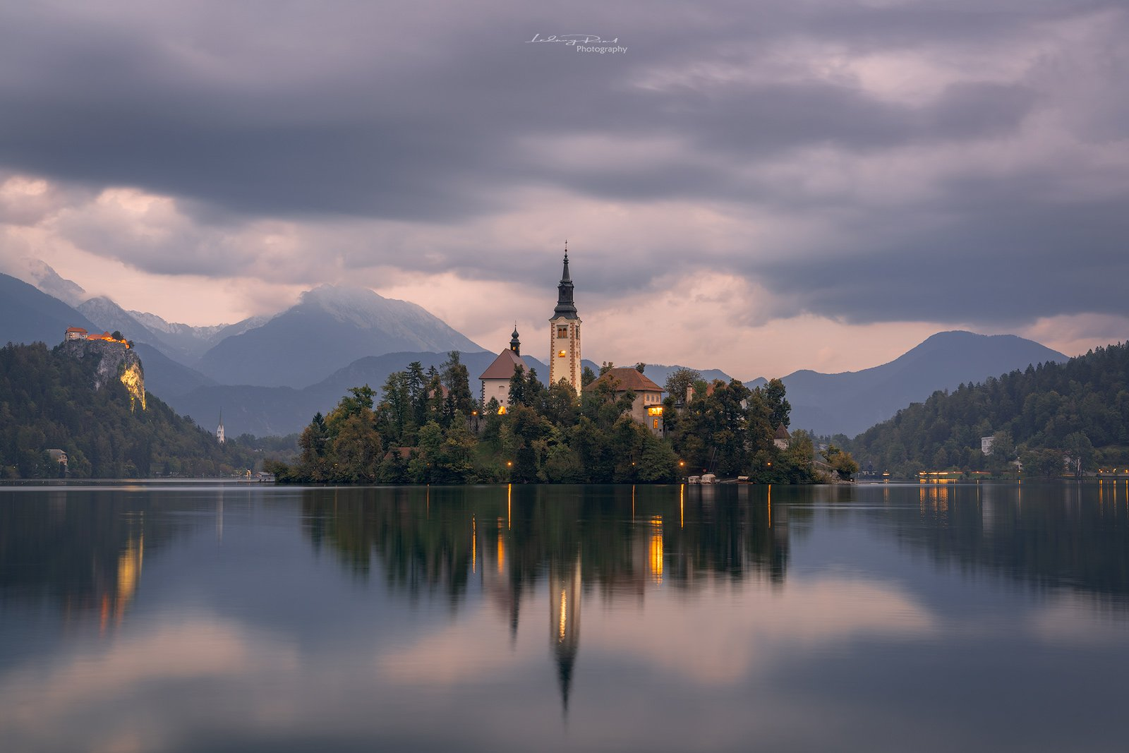bled, blue, blue hour, calm waters, calmness, castle, church, church tower, cliff, clouds, evening, fog, forest, hills, island, lake, lake bled, lights, mountain range, mountains, reflections, rock, serenity, silence, sky, slovenia, tower, twilight, water, Ludwig Riml