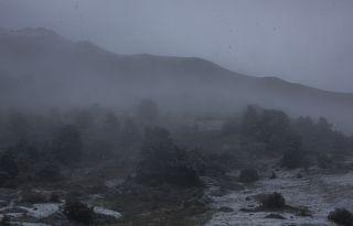 Вид с турбазы Уштулу-снегопад