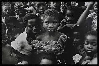 Ghana, boy with chicken.