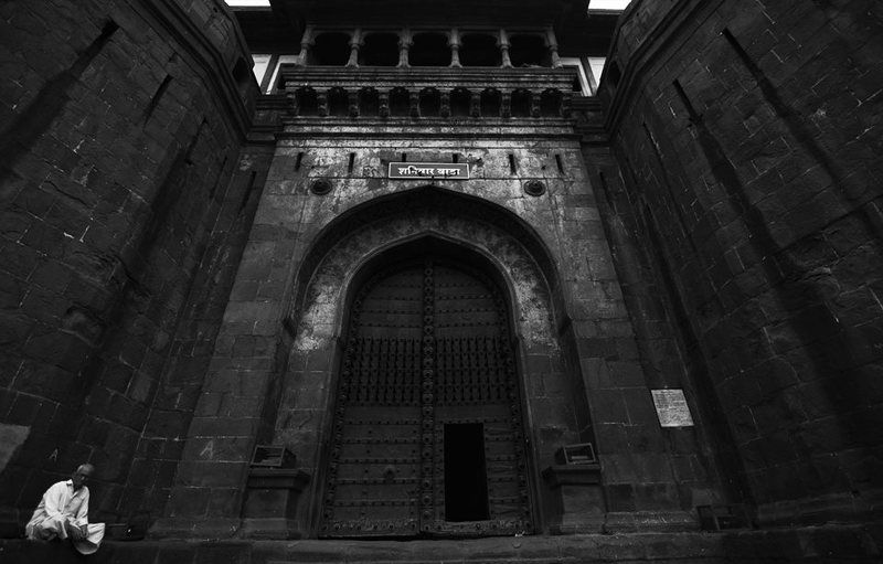 B & w, India wait outsidephoto preview