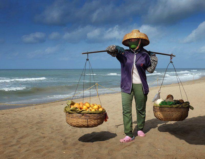хайнань,продавец фруктов Продавец мангоphoto preview
