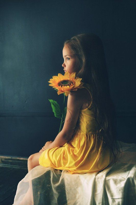 Kid with sunflowerphoto preview