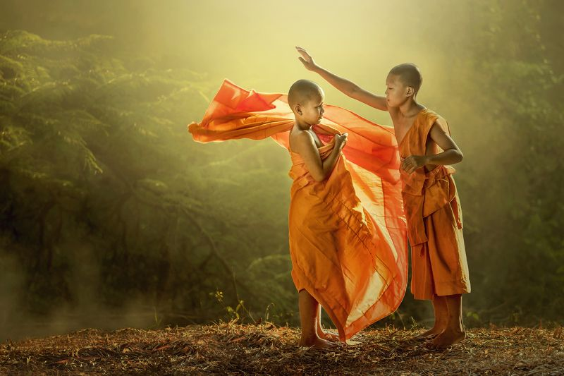 2015, Asia, Buddhism, Color Image, Getting Dressed, Holding, Horizontal, Leisure Activity, Monk - Religious Occupation, Nepal, Novice Buddhist Monk, Orange Color, Outdoors, People, Photography, Shaved Head, Summer, Thai Culture, Thailand, Tropical Climate Young buddhist monk getting dressed.photo preview
