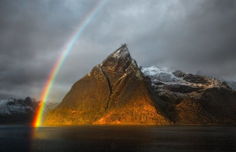 lofoten, norway, polar circle, rainbow, peak, sunset, snow Stormy rainbowphoto preview