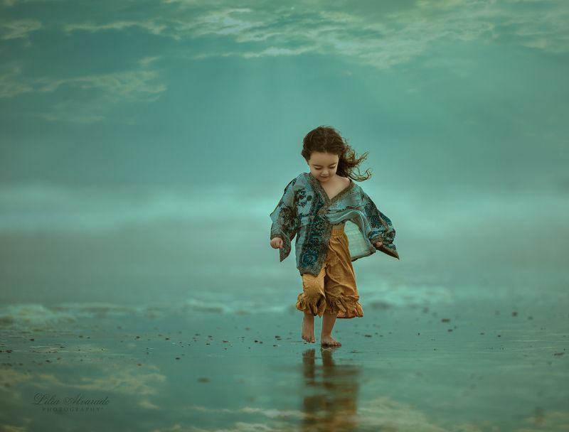 water,reflection,girl,walking,wind,windy,blue,marine, brunette,flow,beach,smiling,candid Feel The Windphoto preview
