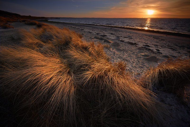 sunset baltic sea beach,schleswig-holstein kiel Baltic beachphoto preview