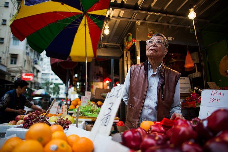 Гонконг Продавцы с рынка в Гонконгеphoto preview