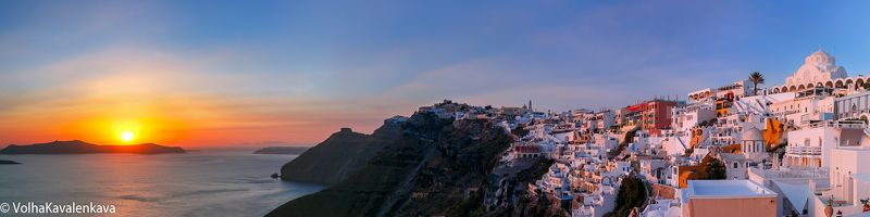 Фира Тирa санторини греция закат Fira sunset Santorini Greece панорама Panorama of Fira at sunset, Santorini, Greecephoto preview
