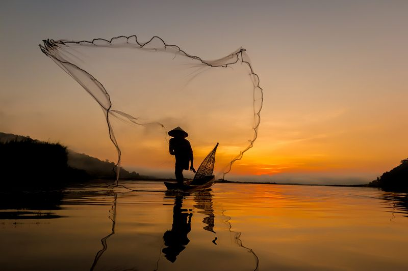 fisherman; thailand; le; net; burma; tropical; river; travel; sunrise; province; myanmar; lake; poor; balance; traditional; bangkok; asia; poverty; mirror; kayak; reflection; tradition; blue; laos; sunset; sap; weed; boat; tourism; ripple; tonle; water; n Silhouette of asian fisherman.photo preview