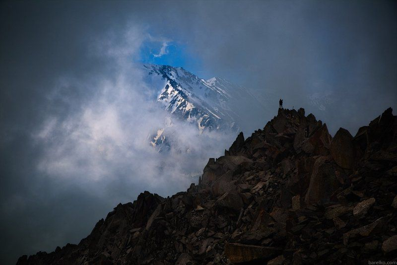 Big, Almaty, Peak, with, hiker, on, top Big Almaty Peak with hiker on top.photo preview