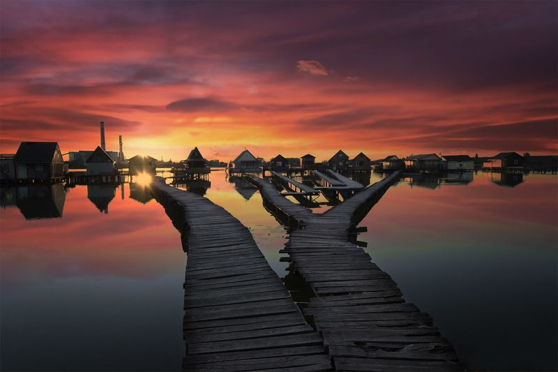 lake, huts in water, sunset, water, clouds, colors, reflections Fishing huts at sunsetphoto preview