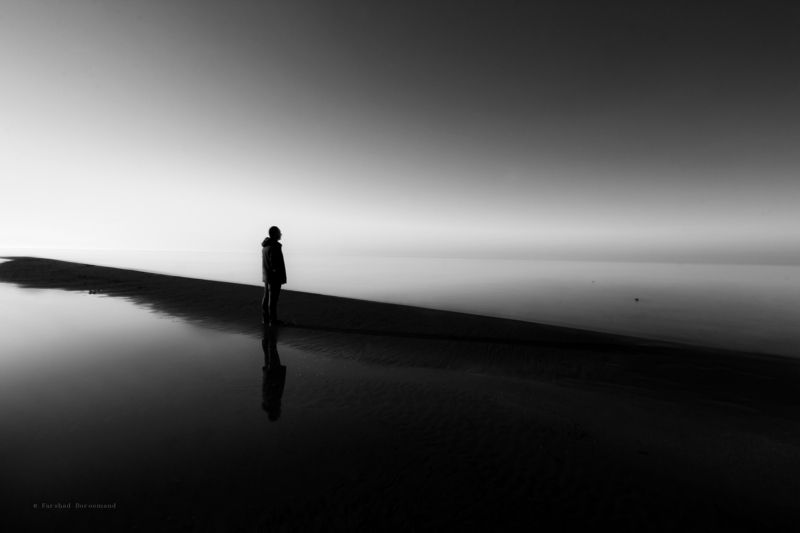 blackandwhite - longexpo - fine art - beach - monochrome - alone among light and darknessphoto preview