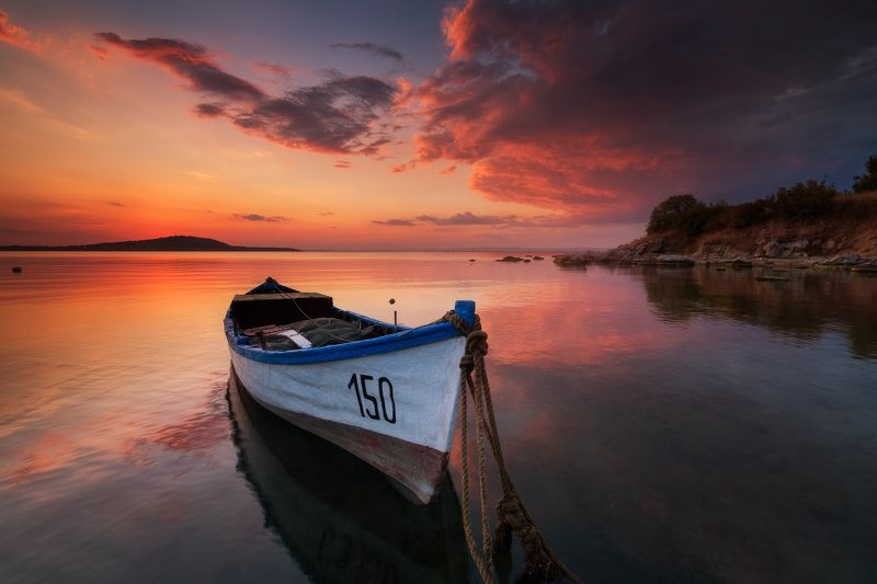 Lonely boat at sunsetphoto preview