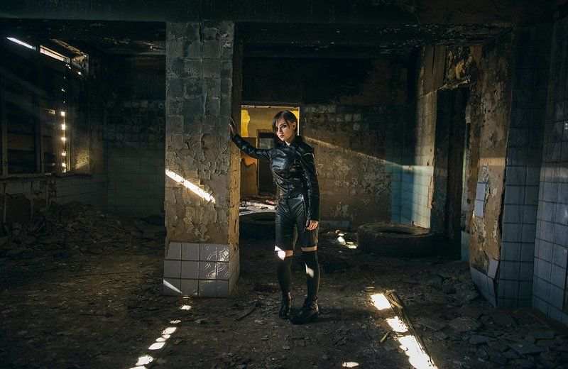 The abandoned building sunlight, girl, beauty,short hair, tiled walls, after the war,rays,leather jacket,Apocalypse Переходphoto preview