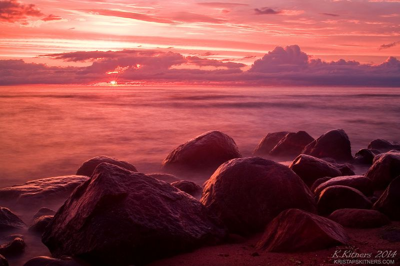 sea seascape water sky clouds stone reflection sunset evening latvia Pink And Redphoto preview