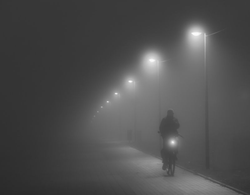 cyclist in the fog photo preview