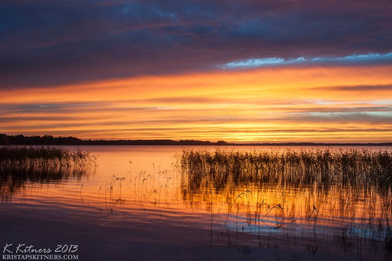 lake grass forest sky clouds water reflection autumn sunset evening latvia Sunset On The Lakephoto preview