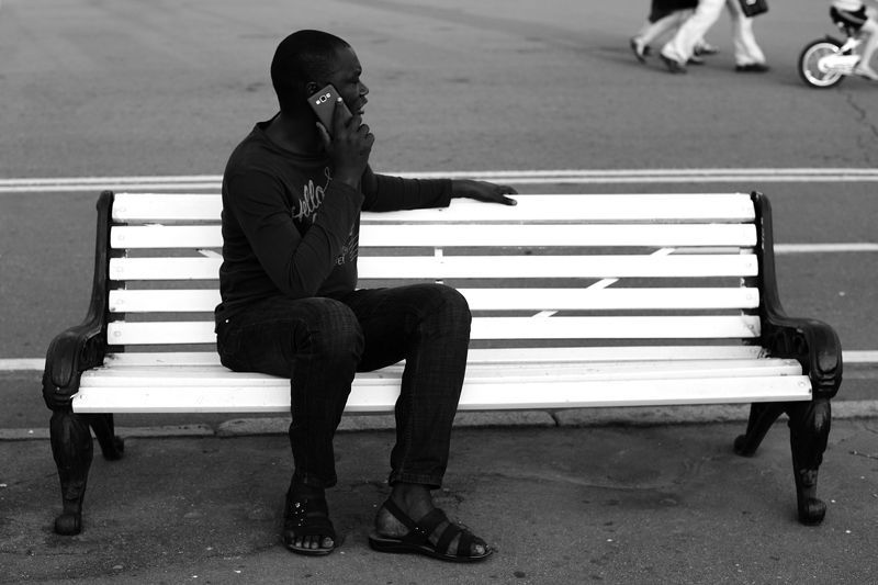 black man white banch street photo Black man on white benchphoto preview