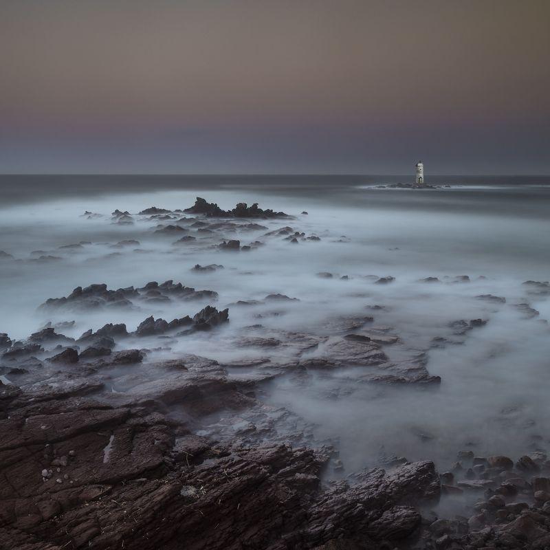 sunrise,sardinia,lighthouse,nikon D850,zeiss 21distagon,travel,log exposure,rocks,sea,sky, behind surisephoto preview