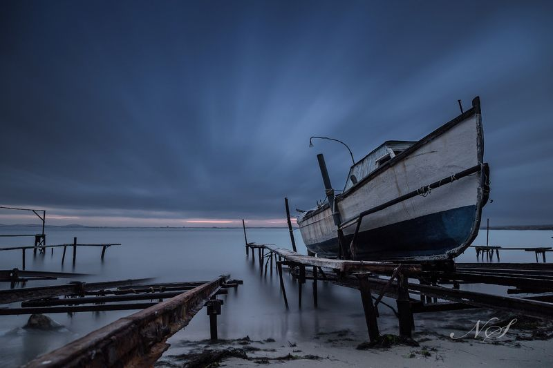 black sea, boat, beach, bulgaria, long exposure Fishing boat on the beachphoto preview