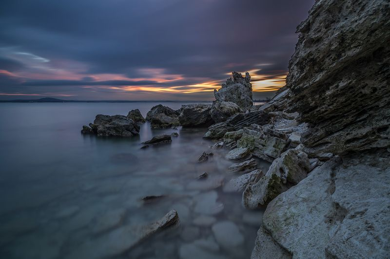 black sea, bulgaria, cliff, island, landscape, long exposure, nature, sea, seascape, sunset, travel Sunset over the rocky beachphoto preview