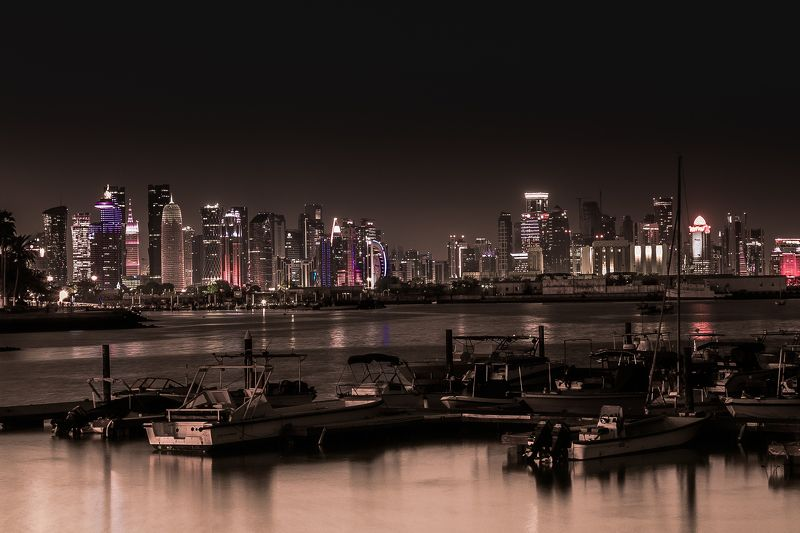#doha #qatar #nationalday #downtown #downtown #qatar #light #light_shot #night #landscape #seascape #clouds #midnight #d #500px #500pxphoto #35awards #city #home #shades #view #beautiful #landscape #me #happy #enjoy #life #iphone #pictures #december Doha Downtown nightscapephoto preview