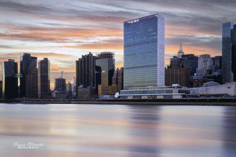 нью-йорк, город, вечер, река, длиннаявыдержка Здание штаб-квартиры ООН в Нью-Йоркеphoto preview