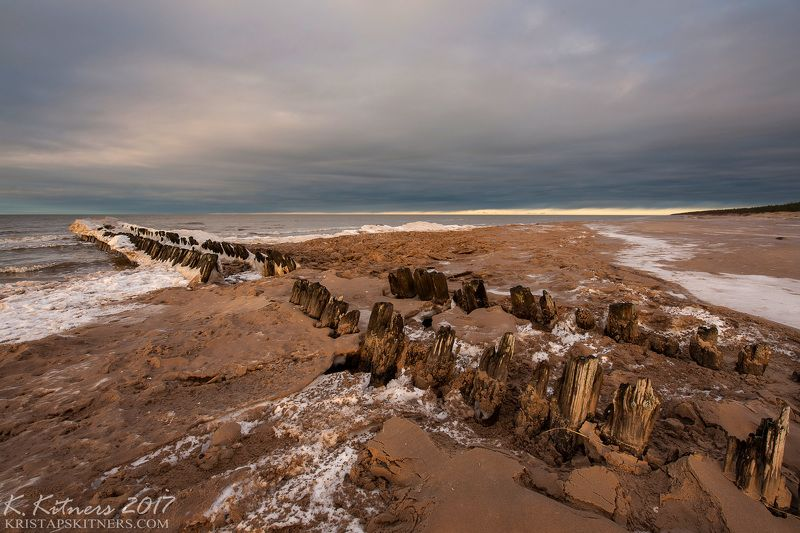 sea seascape ice snow winter sky clouds pier evening latvia Pier In Winterphoto preview