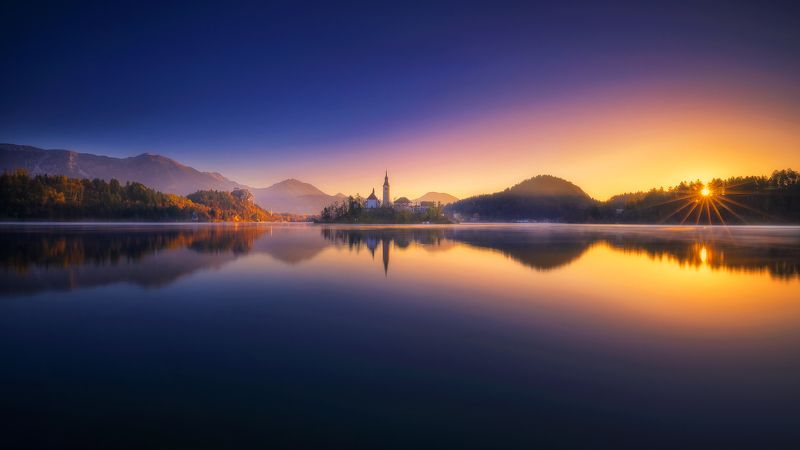 bled slovenia reflection sunstar europe bled in the morningphoto preview