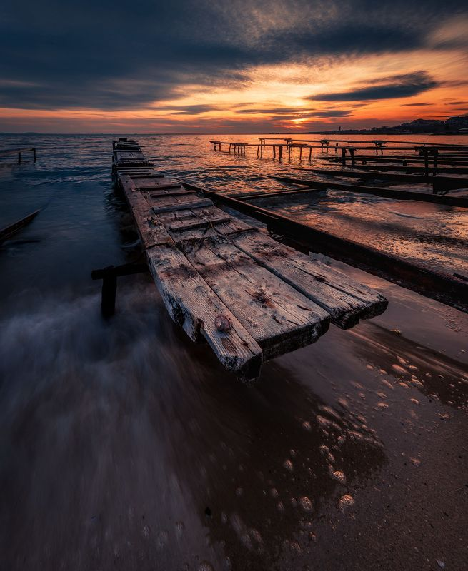 sea,sunset,pier,water,wave,sky,sun,outdoor,landscape,beautiful Waiting...photo preview