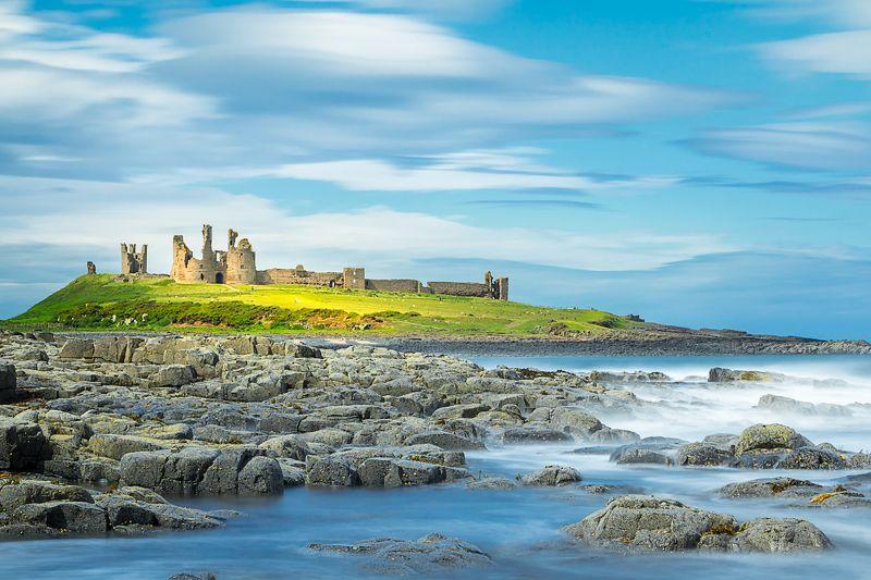 sea long exposure castle clouds landscape beautiful scenery Dunstanburgh Castle. Northumberland photo preview