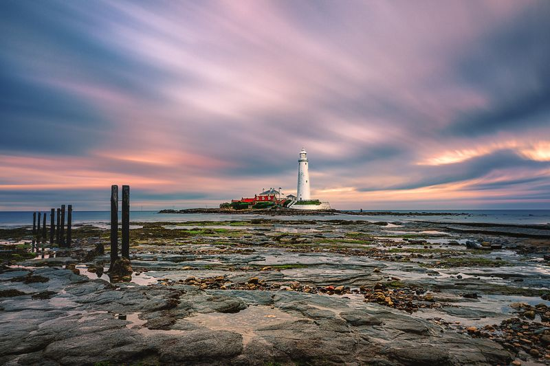 Lighthouse, Low tide, sunset, North sea Low tide. Saint Mary\'s Lighthousephoto preview