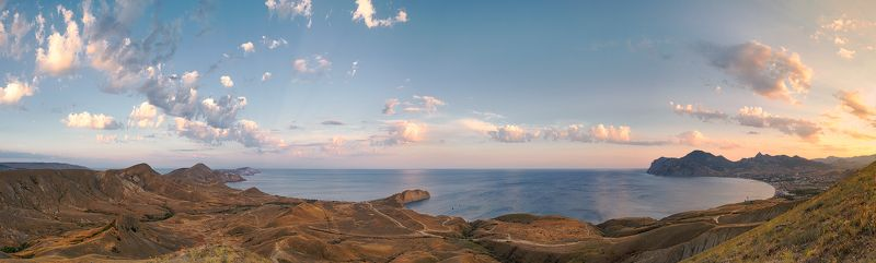 sunset, Black Sea, seacost, seashore, cloudy day, mountaine range A Panorama of Silent Bay and Koktebel at sunset. Black Sea. Crimeaphoto preview