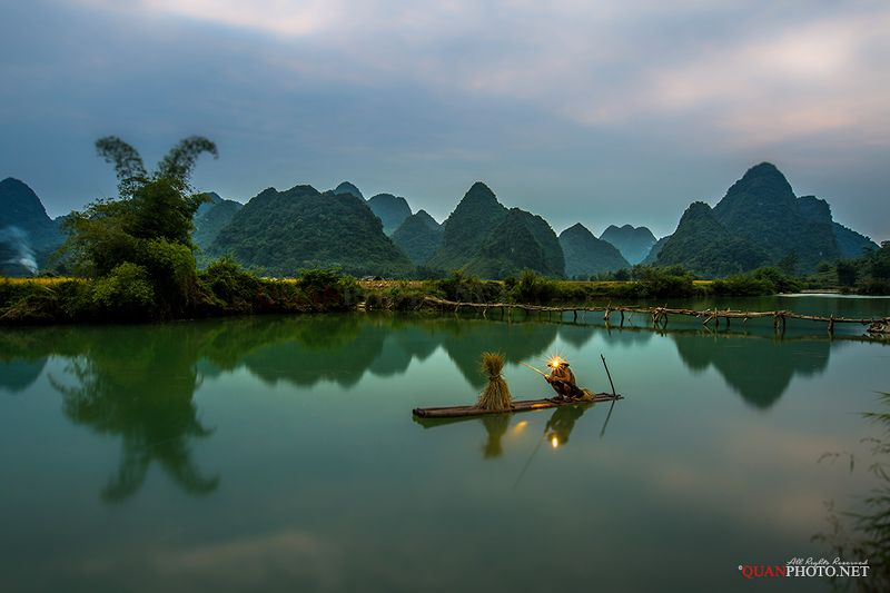 quanphoto, landscape, people, long_exposure, fisherman, fishing, mountains, reflections, river, blue_hour, rural, vietnam Fisherman on the Riverphoto preview