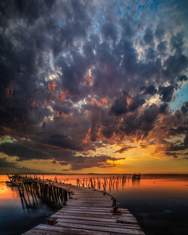 portugal,old pier,sunset,dramatic sky,water,long exposure,evening color,photopills,nikon,zeiss distagon dramatic eveningphoto preview