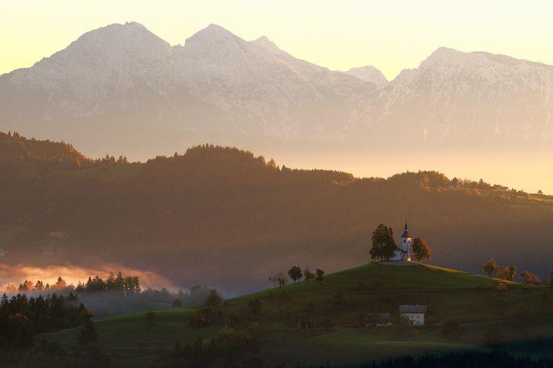 chapel, church, mist, mountains, light, morning, sunrise, forest, hills, slovenia Sveti Tomažphoto preview