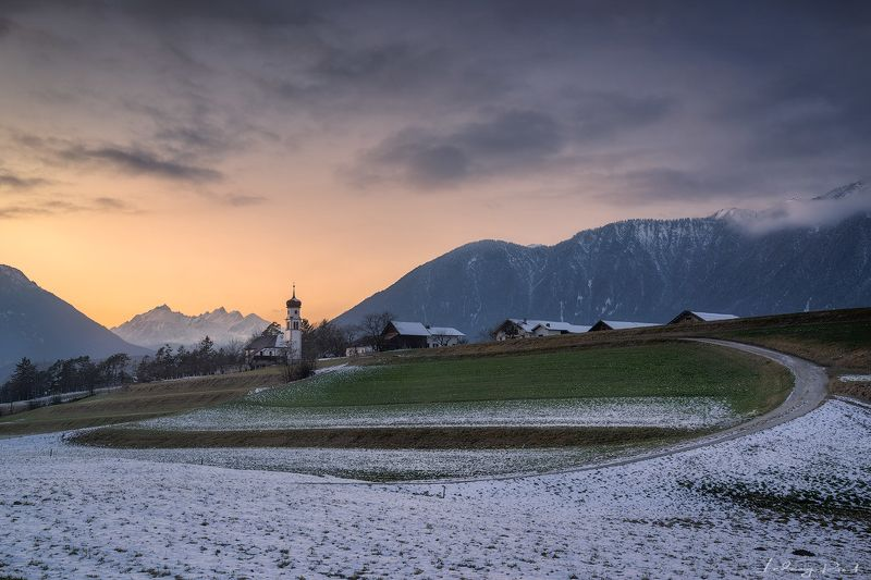 acres, agicutural building, agriculture, alps, austria, austrian alps, bend, bending road, church, clouds, evening, evening glow, farmhouse, fog, foggy, forest, gravel road, hey barn, hill, hills, houses, landscape, meadows, mieming, mieminger plateau, mo Church Upon a Hillphoto preview