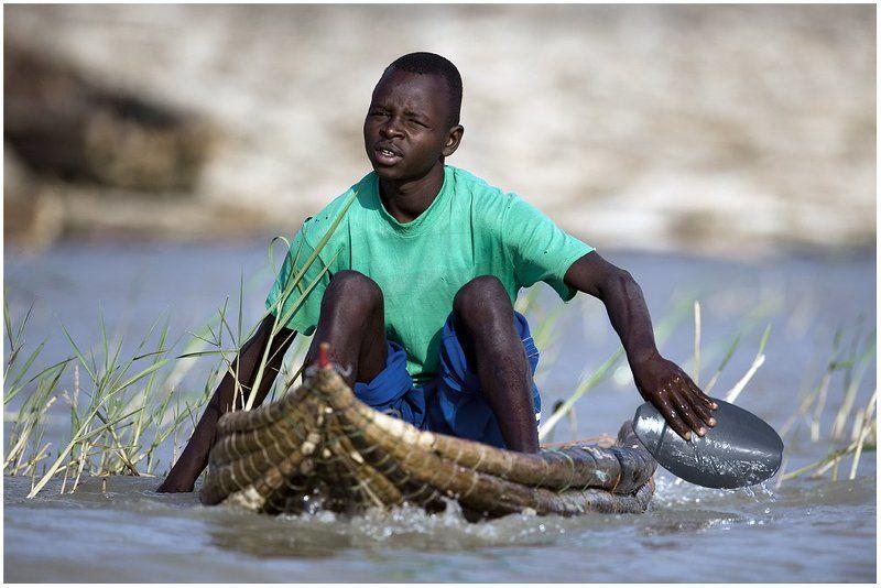 баринго, лодка, рыбак Торговец рыбой.photo preview
