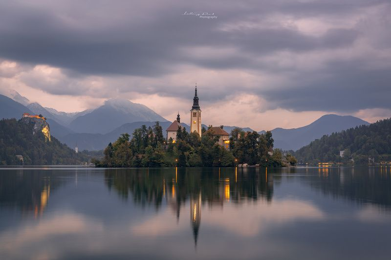 bled, blue, blue hour, calm waters, calmness, castle, church, church tower, cliff, clouds, evening, fog, forest, hills, island, lake, lake bled, lights, mountain range, mountains, reflections, rock, serenity, silence, sky, slovenia, tower, twilight, water Lake Bledphoto preview