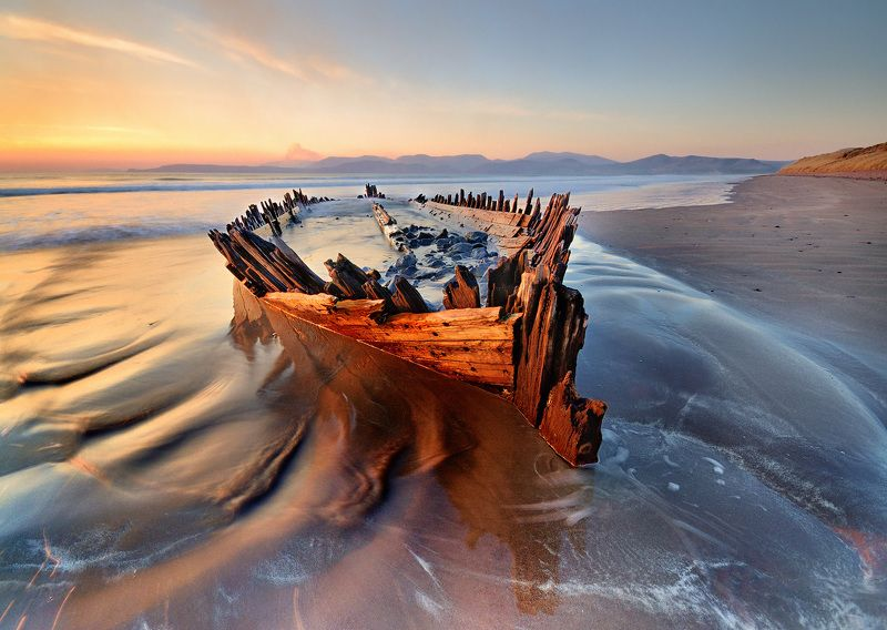 ireland, kerry, rossbeigh, sunset, wreck, boat, ship, beach, iconic, mountains. color, red Wreckedphoto preview