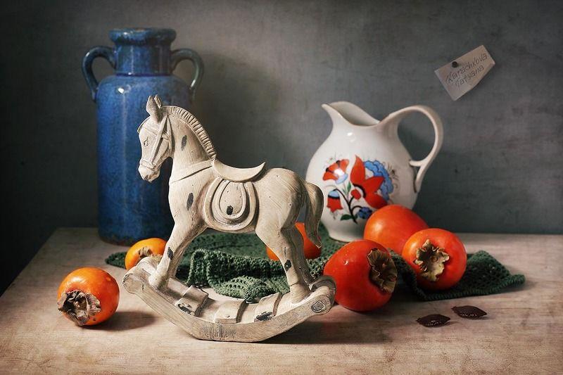 натюрморт, кувшин, хурма, фрукты, игрушка, лошадь Купила мама коника...photo preview
