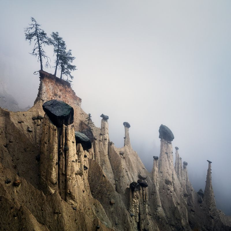 earth pyramids, fog, mist, italy, italia, europe, landscape, nature, mood, autumn, fall, rocks, hoodoos Silent Planetphoto preview