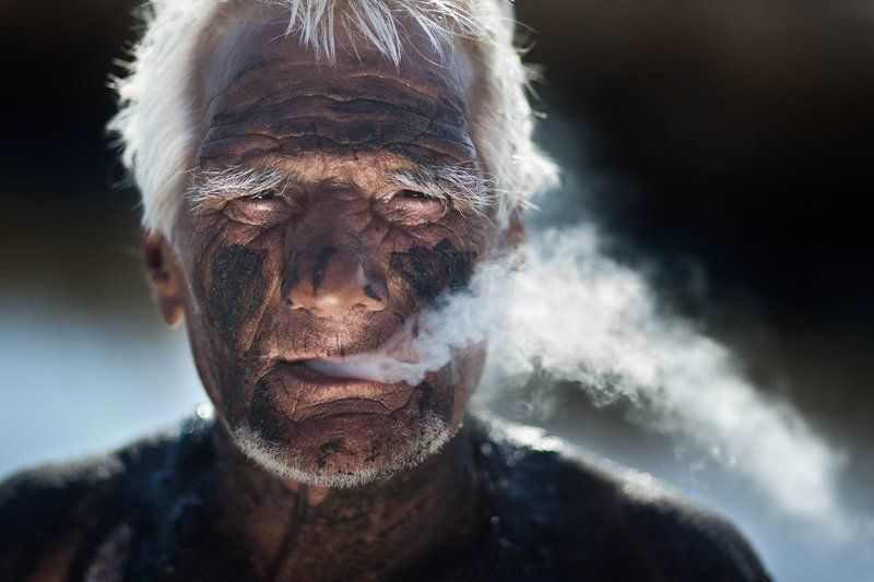 mud bath, smoke, old man, wrinkles, salt mine near sea Mud bathsphoto preview