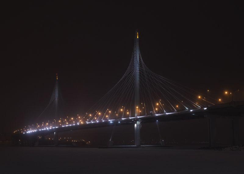 залив зима мост автомост вантовый снег дорога город огни Над зимним заливомphoto preview