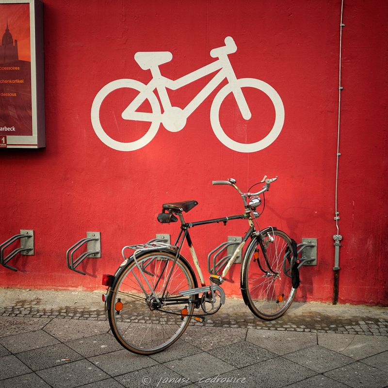 berlin, germany,street,city,sidewalk,parking,bike,bicycle,cycling,urban,traffic,sign,wall,painting,fuji two bicyclesphoto preview