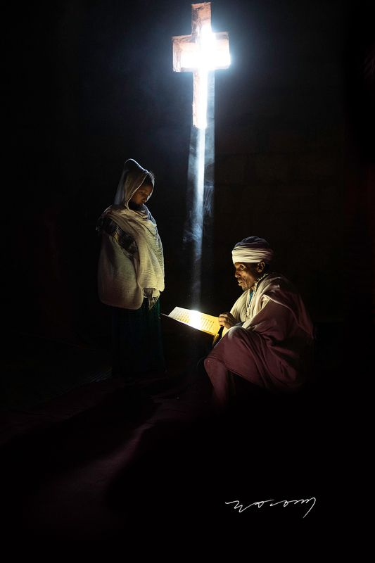 lalibela , ethiopia , orthodox church , monolithic rock-hewn , priest , girl , light  , the cross WORSHIPphoto preview