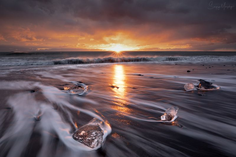 sunrise on black send beach. iceland. Sunrise on black send beach. Iceland.photo preview